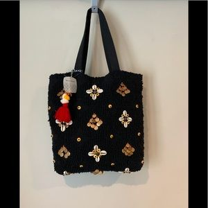 World Market lined purse with embellishments.